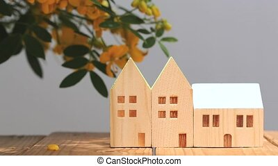 wooden toy house with flower