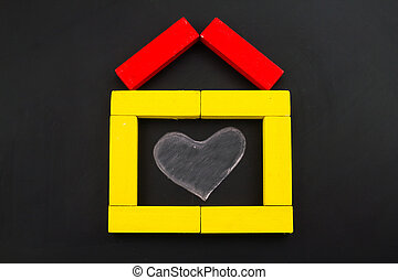 Wooden toy house with heart inside