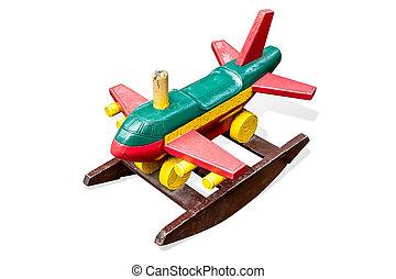 Wooden toy passenger jet plane on white background