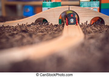 Wooden toy train in kids room