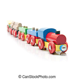 Wooden toy train with a locomotive and five carriages with a subtle reflection on a white background and a shallow depth of field