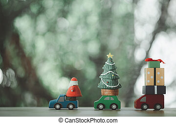 Wooden toy with Santa Claus, Christmas tree and gift box, end of season.
