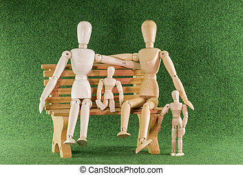 wooden toys as family on bench