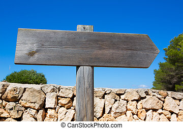 Wooden track blank road sign in Mediterranean Balearic