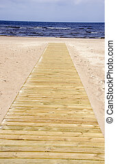wooden track on the beach and sea resort