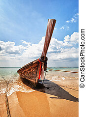 Wooden traditional boat on the beach - Thailand