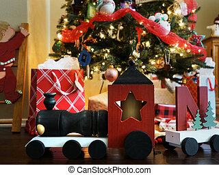 Wooden train and gifts under a Christmas Tree