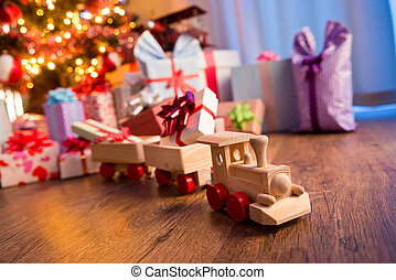 Wooden train with christmas gift