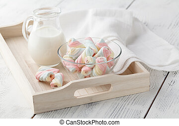 Wooden tray with a cup of milk and marshmallow