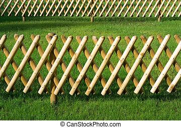 Wooden trellis, grass
