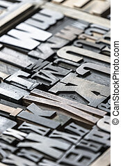 Wooden type blocks for old printing press.