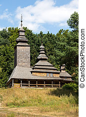 Wooden ukrainian antique orthodox church in summer in Pirogovo museum, Kiev, Ukraine