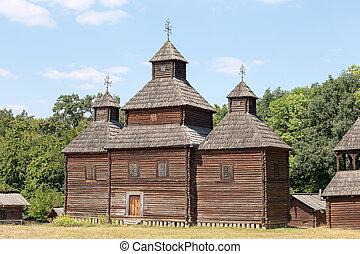 Wooden ukrainian antique orthodox church in summer . Pirogovo museum, Kiev, Ukraine