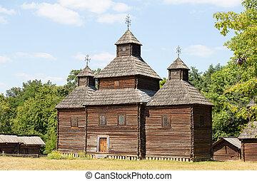 Wooden ukrainian antique orthodox church in summer in Pirogovo museum, Kiev, Ukraine