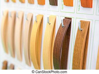 Wooden veneer samples palette closeup. Interline texture...