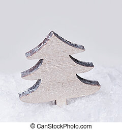 Wooden vintage christmas tree in the snow