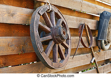 wooden wagon wheel on the fence