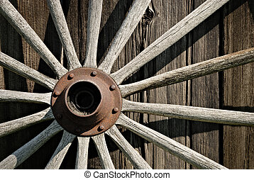 Wooden Wagon Wheel - Old wooden wagon wheel leaning against...