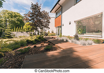 Wooden walkout deck in garden