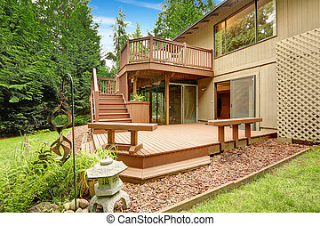 Wooden walkout deck with patio and benches - House with...