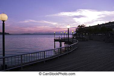 Wooden walkway along the pier at sunset