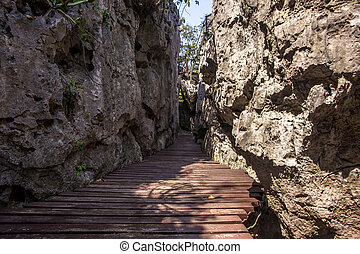 Wooden walkway between the rocks