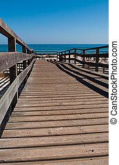 Wooden walkway on beach