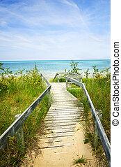 Wooden walkway over dunes at beach - Wooden path over dunes ...