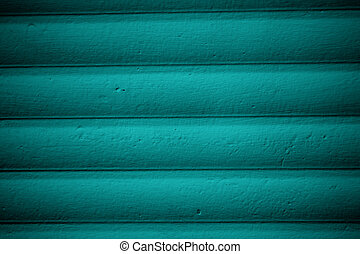Wooden wall painted with blue paint