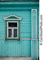 wooden wall with a small window