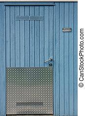 Wooden wall with door