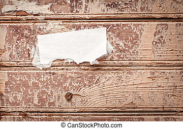 Wooden wall with paper announcement