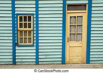 Wooden wall with window and door