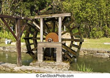 wooden waterwheel in green park