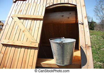 Wooden well with a bucket
