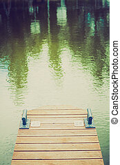 Wooden wharf and blue water