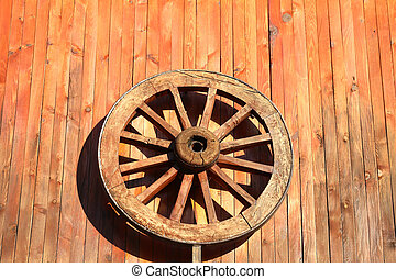 Wooden wheel hanging on the wall