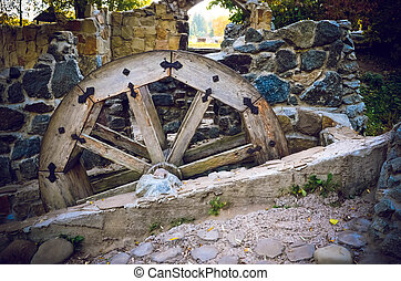 Wooden wheel of an old watermill on the river