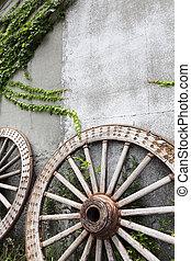Wooden wheel on old brick wall