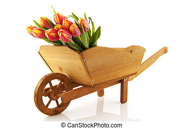 wooden wheelbarrow with flowers