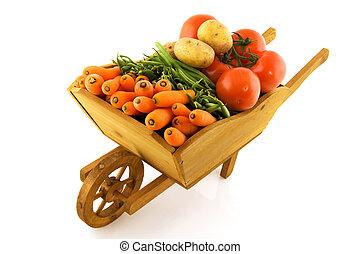 Wooden wheelbarrow with vegetables