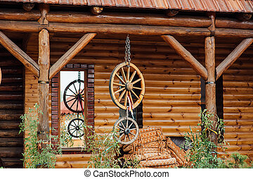wooden wheels hanging on a rope near the wall