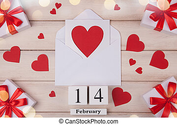 Wooden white background with red hearts, gifts, love ...
