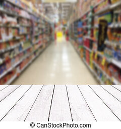 Wooden white balcony on blur of inside supermarkets background
