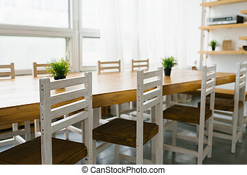 white chairs with a brown seat in the kitchen or dining room in Scandinavian style