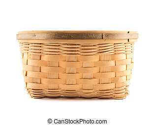 Wooden wicker basket isolated over white background, front view