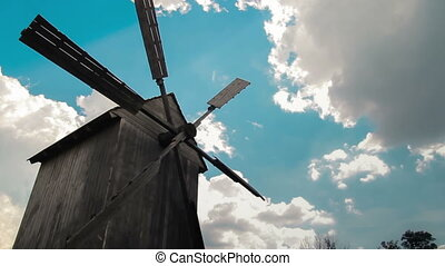 Wooden windmill time lapse clouds