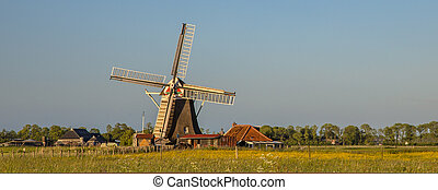 Wooden windmill with miller house