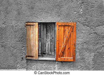 wooden window in a rustic wall. Processed for selective ...