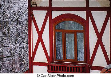 Wooden window in a snowy forest